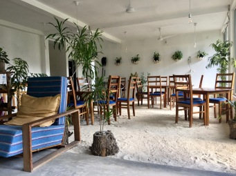 Sand floor dining area at Island Break